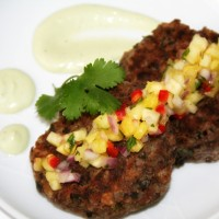 Black Bean Cake with Pineapple Salsa and Avocado Crema